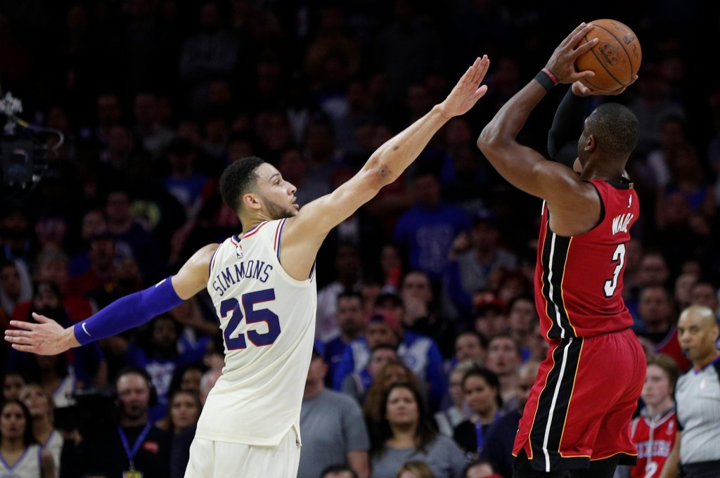 Miami Heat's Dwyane Wade, right, shoots with Philadelphia 76ers' Ben Simmons, left, of Australia, defending during the second half in Game 2 of a firs