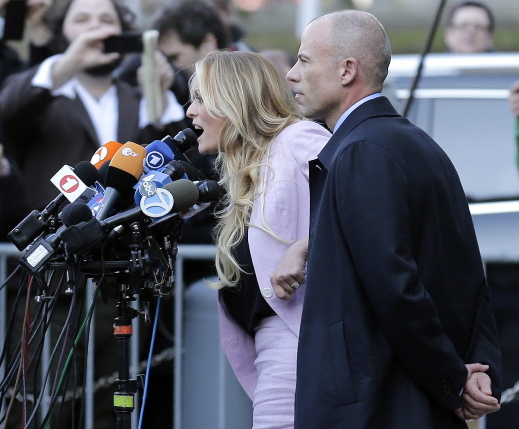 Adult film actress Stormy Daniels, left, speaks as her lawyer Michael Avenatti listens outside federal court, Monday, April 16, 2018, in New York. (AP