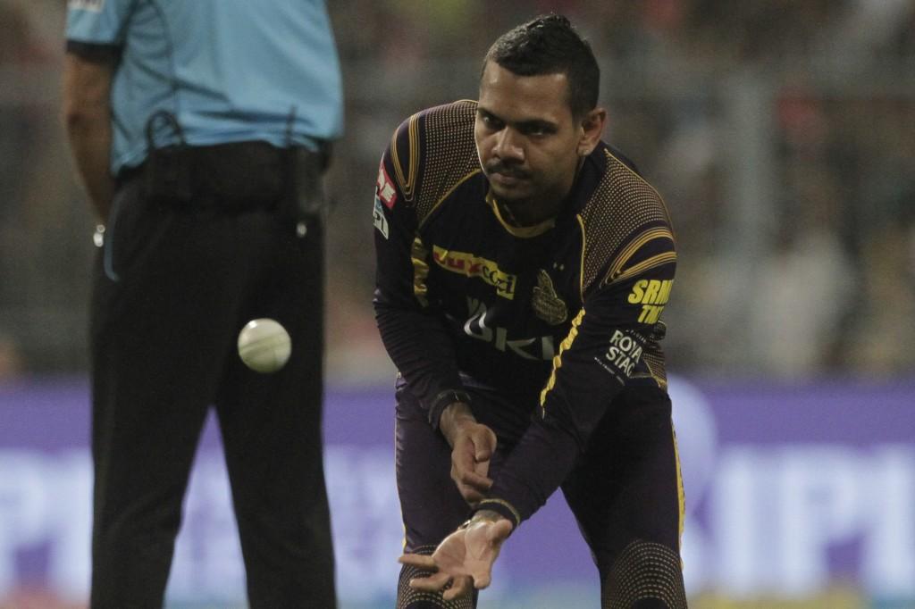 Kolkata Night Riders' Sunil Narine collects a ball during VIVO IPL cricket T20 match against Delhi Daredevils in Kolkata, India, Monday, April 16, 201
