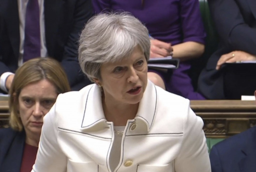 Britain's Prime Minister Theresa May makes a statement to MPs in the House of Commons in London, Monday April 16, 2018 over her decision to launch air