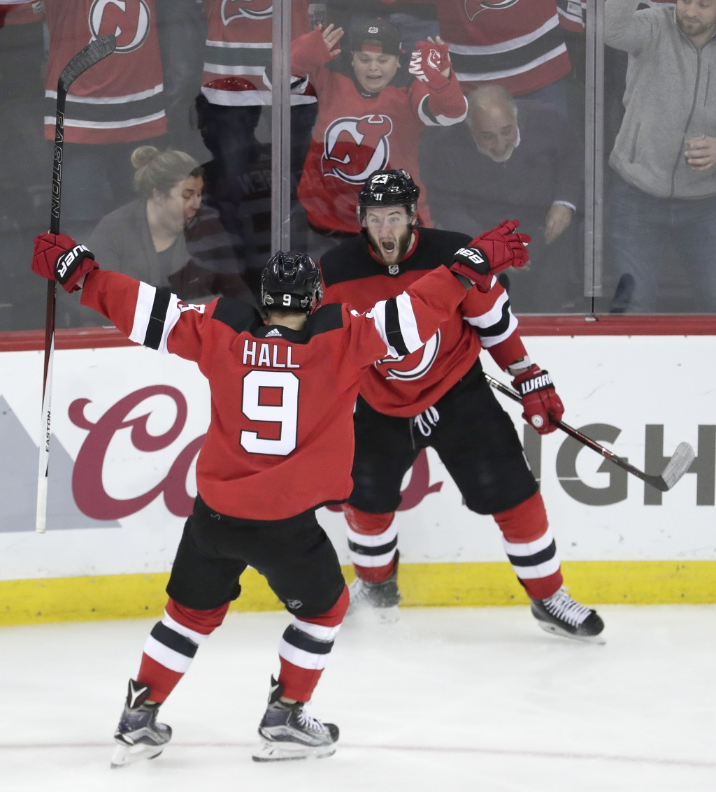 New Jersey Devils right wing Stefan Noesen, right, celebrates his goal against the Tampa Bay Lightning with teammate Taylor Hall (9) during the third