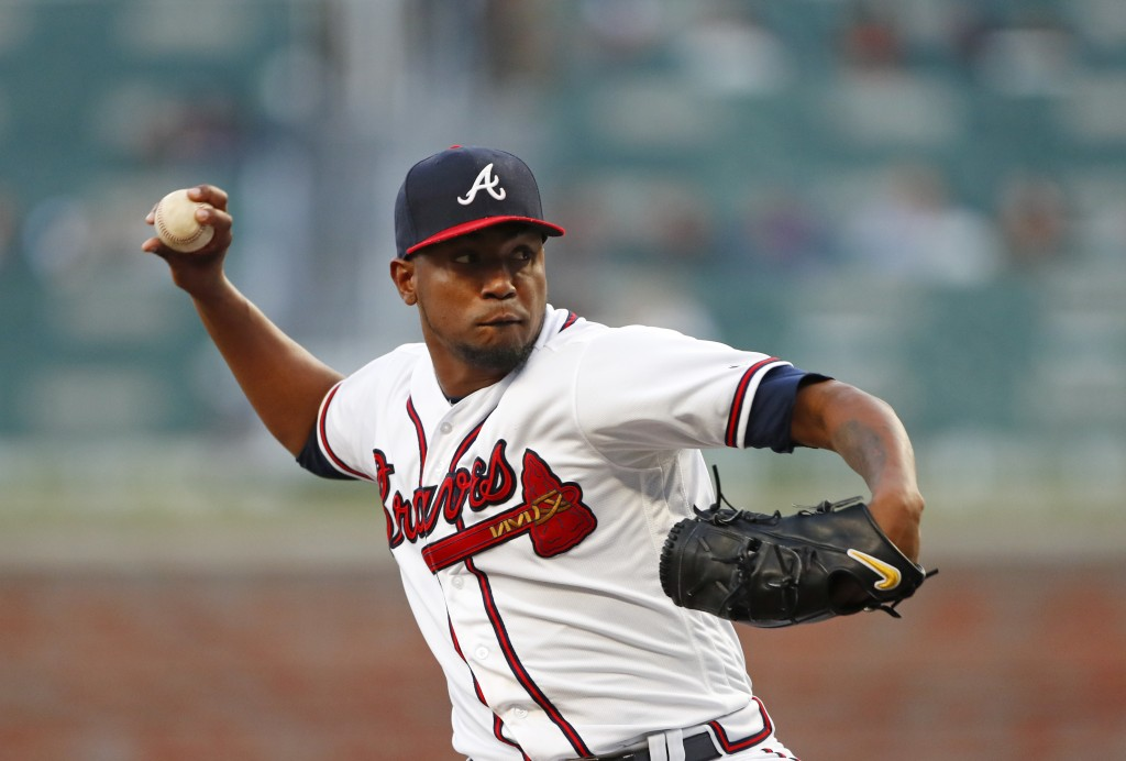 Atlanta Braves starting pitcher Julio Teheran (49) works in the first inning of a baseball game against the Philadelphia Phillies Monday, April 16, 20