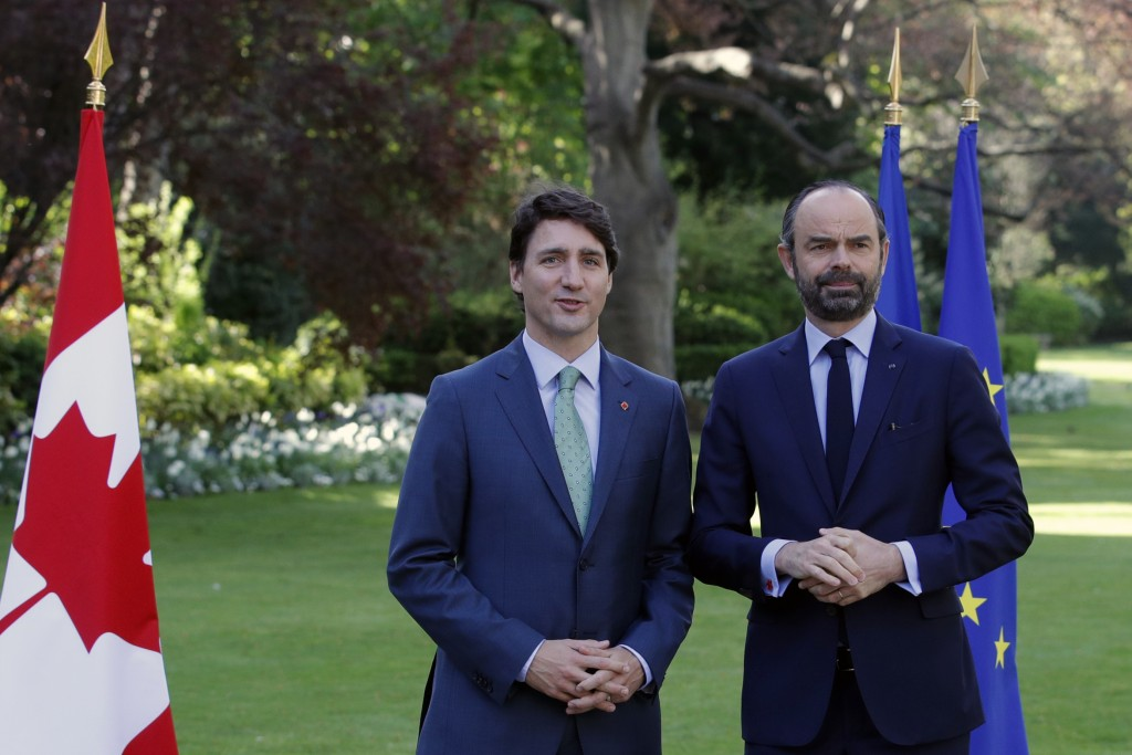 French Prime Minister Edouard Philippe, right, and Canadian Prime Minister Justin Trudeau attend a meeting at the Hotel Matignon in Paris, France, Tue