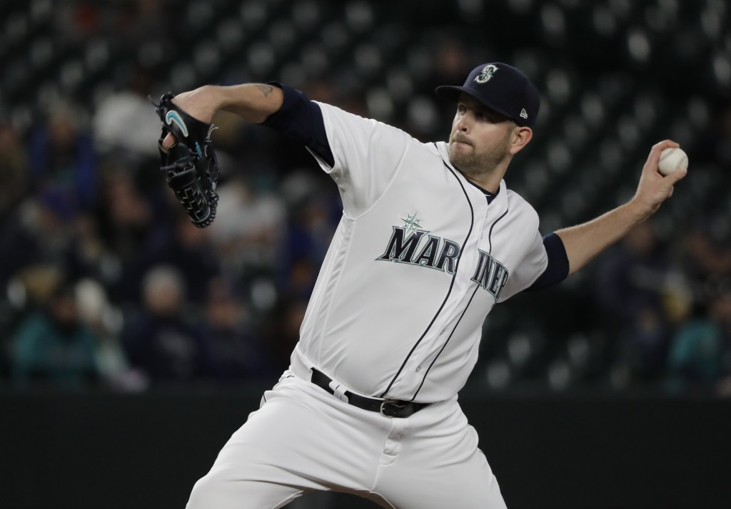 Seattle Mariners starting pitcher James Paxton throws against the Houston Astros in the first inning of a baseball game, Monday, April 16, 2018, in Se