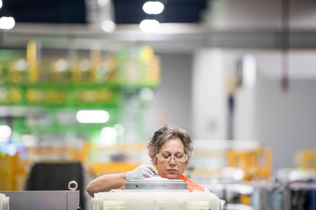 FILE- In this March 16, 2018, file photo, Teresa Free works on the assembly line at the Samsung washing machine facility in Newberry, S.C. On Tuesday,