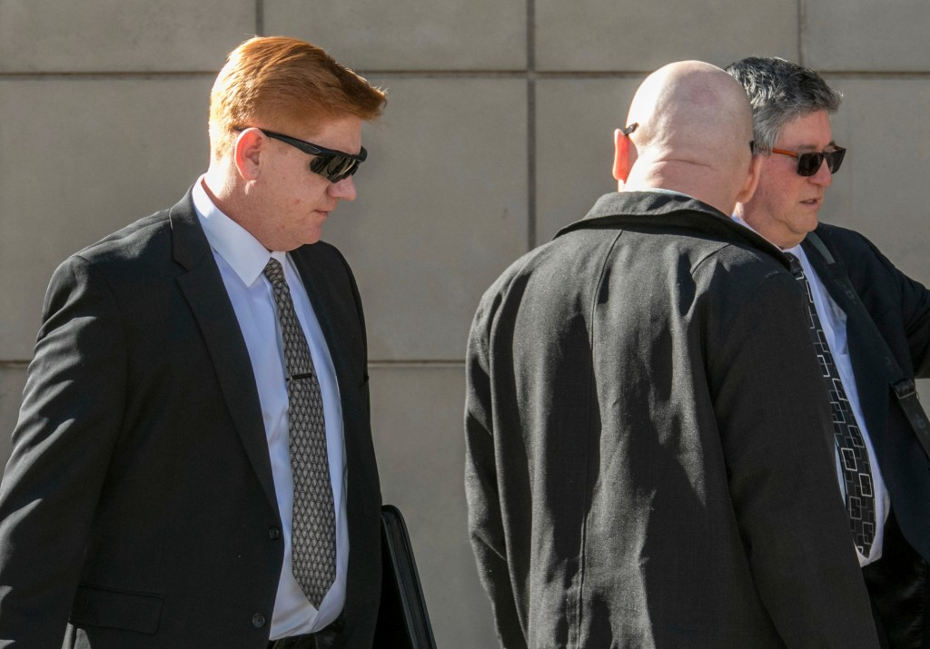 FILE - In this March 21, 2018, file photo, Border Patrol agent Lonnie Swartz, left, makes his way to the U.S. District Court building in downtown Tucs