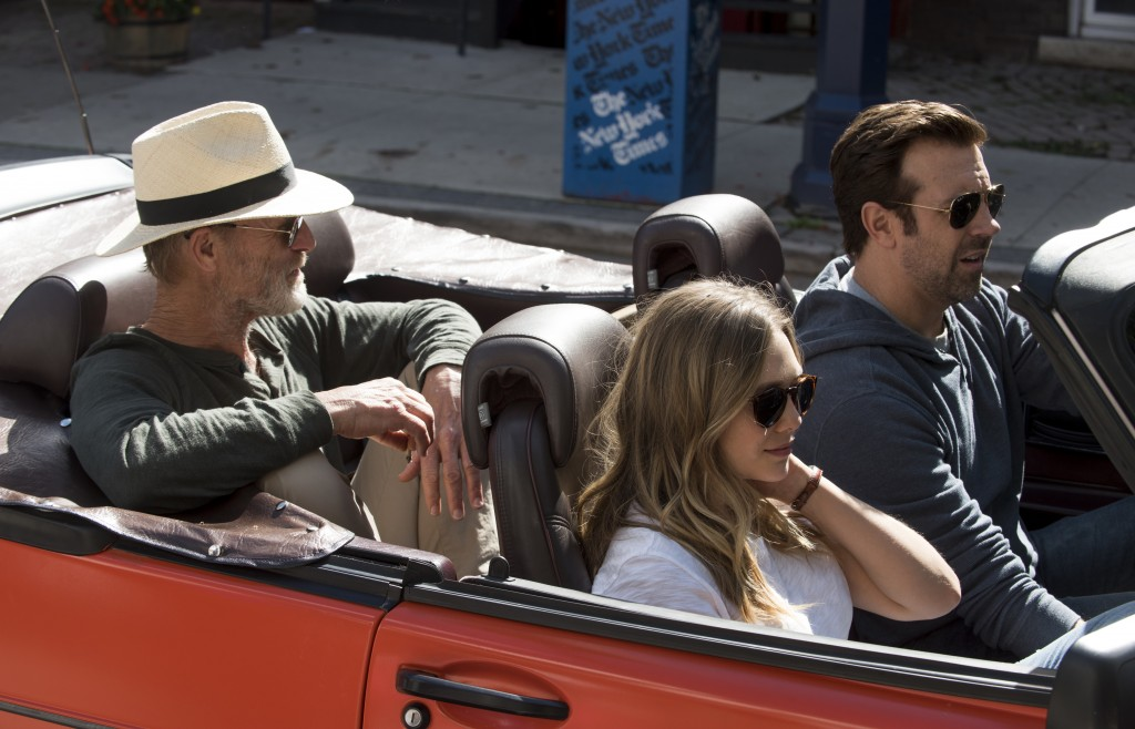 """This image released by Netflix shows Ed Harris, from left, Elizabeth Olsen and Jason Sudeikis in a scene from """"Kodachrome."""" (Christos Kalohoridis/Netf"""