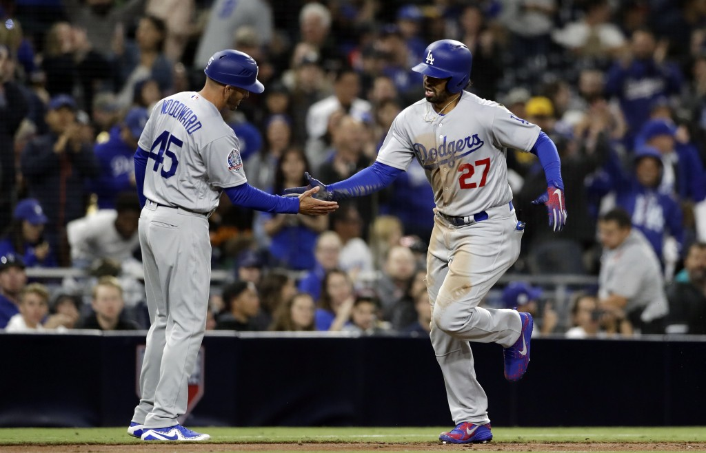Los Angeles Dodgers' Matt Kemp, right, is greeted by third base coach Chris Woodward (45) after hitting a three-run home run during the third inning o