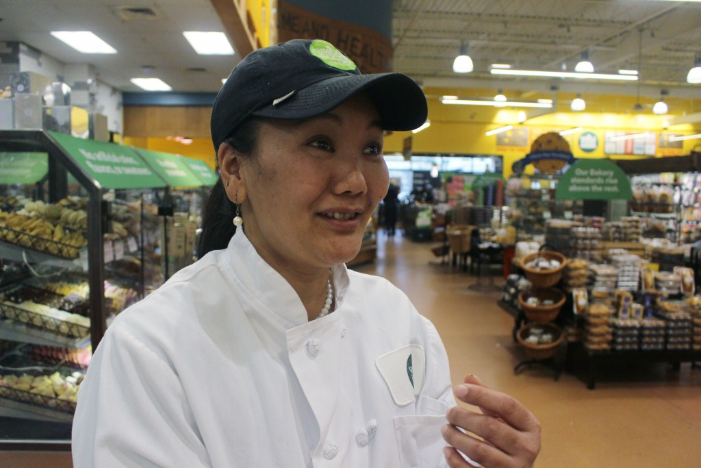 In this April 3, 2018, photo, mountain climber Lhakpa Sherpa prepares to start her shift as a dishwasher at the Whole Foods Market in West Hartford, C