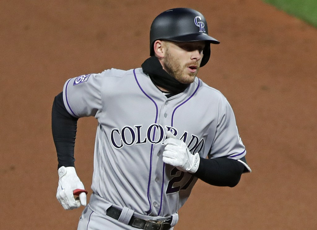Colorado Rockies' Trevor Story rounds second after hitting a three-run home run off Pittsburgh Pirates starting pitcher Steven Braultof in the fourth