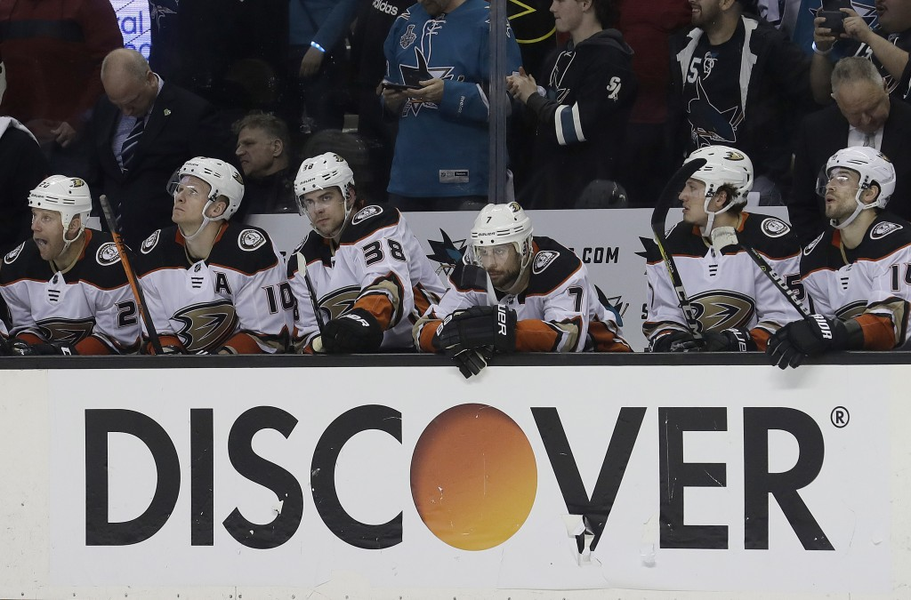 Anaheim Ducks players react on the bench after the San Jose Sharks scored a goal during the second period of Game 3 of an NHL hockey first-round playo