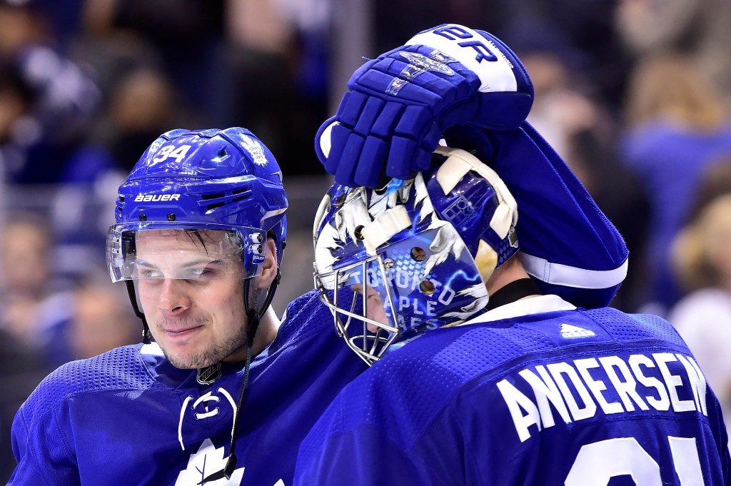Toronto Maple Leafs centre Auston Matthews (34) and goaltender Frederik Andersen (31) celebrate after defeating the Boston Bruins in an NHL round one