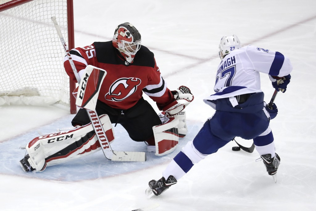 Tampa Bay Lightning defenseman Ryan McDonagh (27) attacks on New Jersey Devils goaltender Cory Schneider (35) during the third period of Game 3 of an