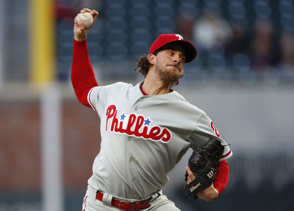 Philadelphia Phillies starting pitcher Aaron Nola (27) works in the first inning of a baseball game against the Atlanta Braves Monday, April 16, 2018,