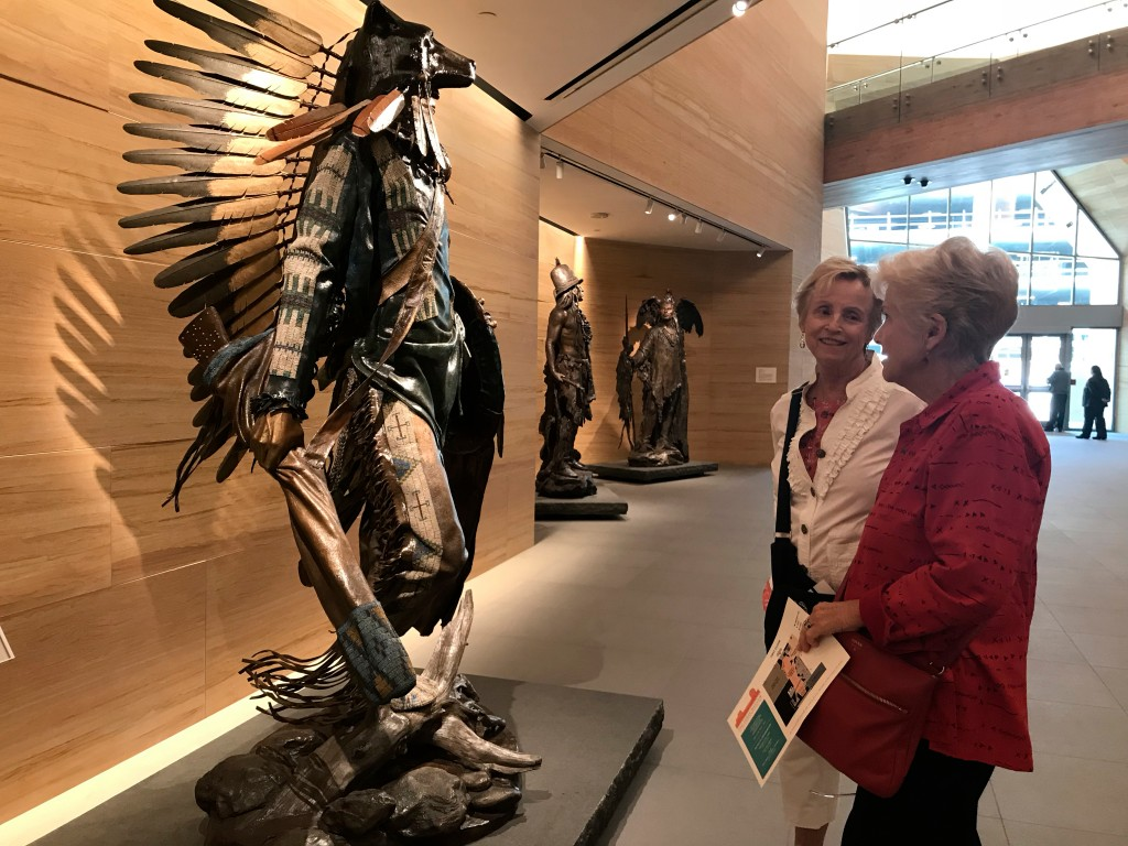 This April 11, 2018 photo shows visitors looking at an installation inside the James Museum of Western & Wildlife Art in St. Petersburg, Fla. When you