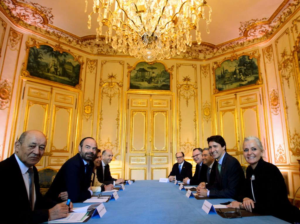 Prime Minister Justin Trudeau, second from right, meets with Prime Minister of France Edouard Philippe, second from left, in Paris, France Tuesday, Ap