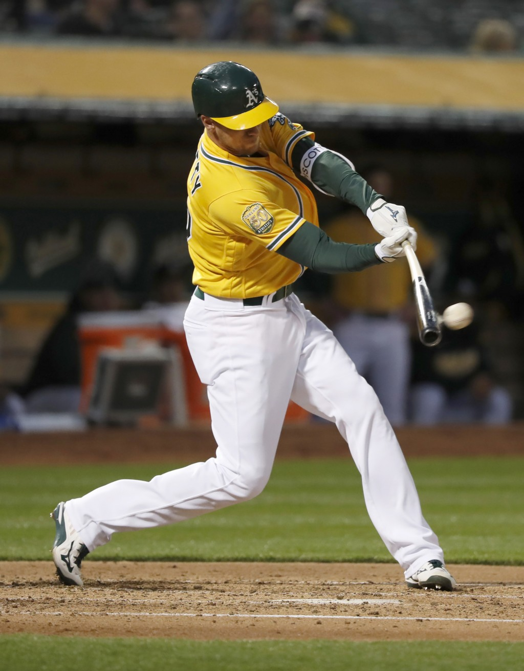 Oakland Athletics' Stephen Piscotty (25) hits a double against the Chicago White Sox during the second inning of a baseball game Monday, April 16, 201