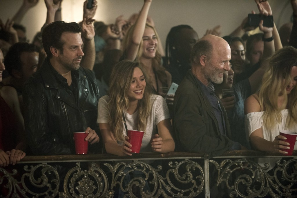 """This image released by Netflix shows Jason Sudeikis, from left, Elizabeth Olsen and Ed Harris in a scene from """"Kodachrome."""" (Christos Kalohoridis/Netf"""