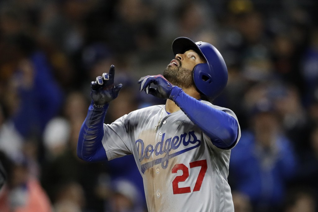 Los Angeles Dodgers' Matt Kemp reacts after hitting a three-run home run during the third inning of a baseball game against the San Diego Padres Monda