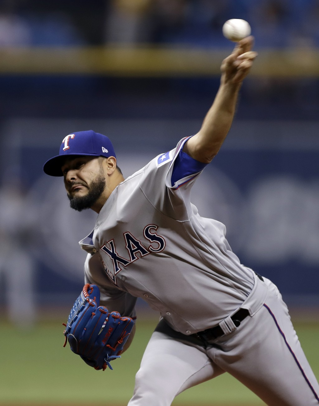 Texas Rangers' Martin Perez pitches to the Tampa Bay Rays during the first inning of a baseball game Monday, April 16, 2018, in St. Petersburg, Fla. (