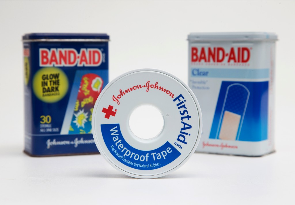 FILE - This Sept. 13, 2016, file photo, shows a selection of Johnson & Johnson brand first aid products arranged for a photo, in Surfside, Fla. Johnso