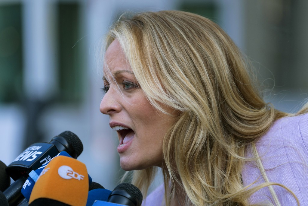 Adult film actress Stormy Daniels speaks to members of the media after a hearing at federal court Monday, April 16, 2018, in New York. A judge conside