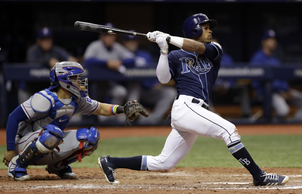 Tampa Bay Rays' Mallex Smith singles off Texas Rangers relief pitcher Jesse Chavez during the fifth inning of a baseball game Monday, April 16, 2018,