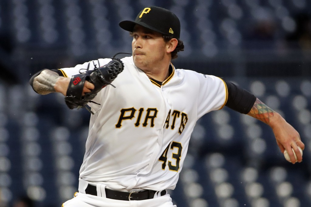 Pittsburgh Pirates starting pitcher Steven Brault delivers in the first inning of a baseball game against the Colorado Rockies in Pittsburgh, Monday,