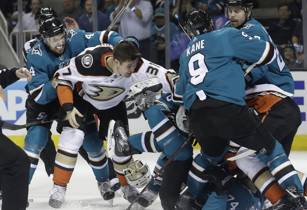 San Jose Sharks defenseman Dylan DeMelo, left, goes after Anaheim Ducks left wing Nick Ritchie (37) as players fight during the second period of Game