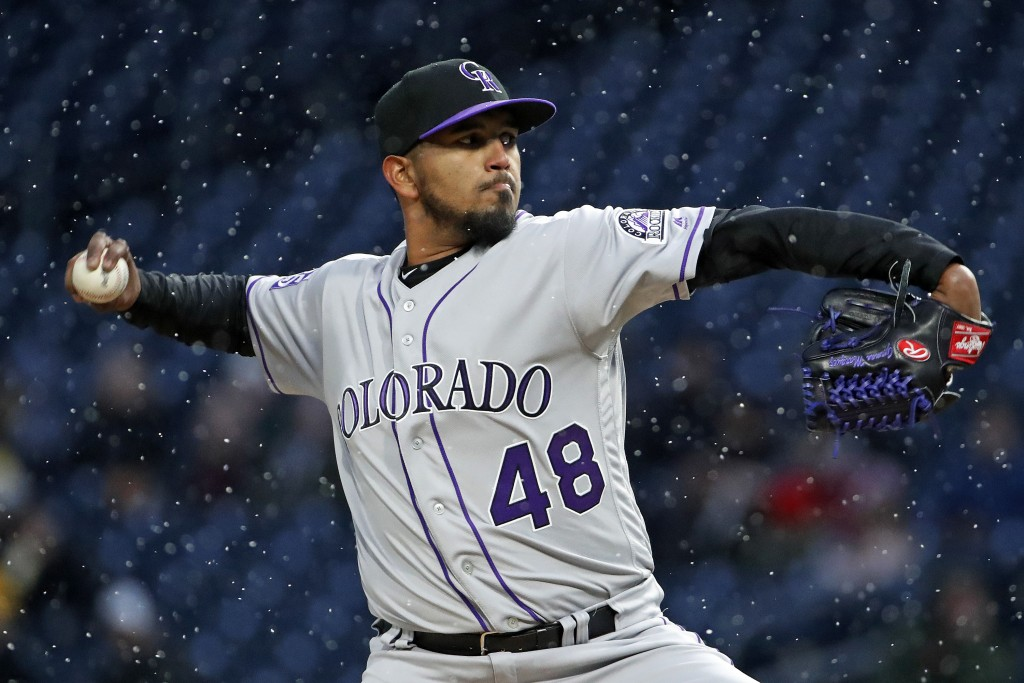 Colorado Rockies starting pitcher German Marquez delivers in the first inning of a baseball game against the Pittsburgh Pirates in Pittsburgh, Monday,