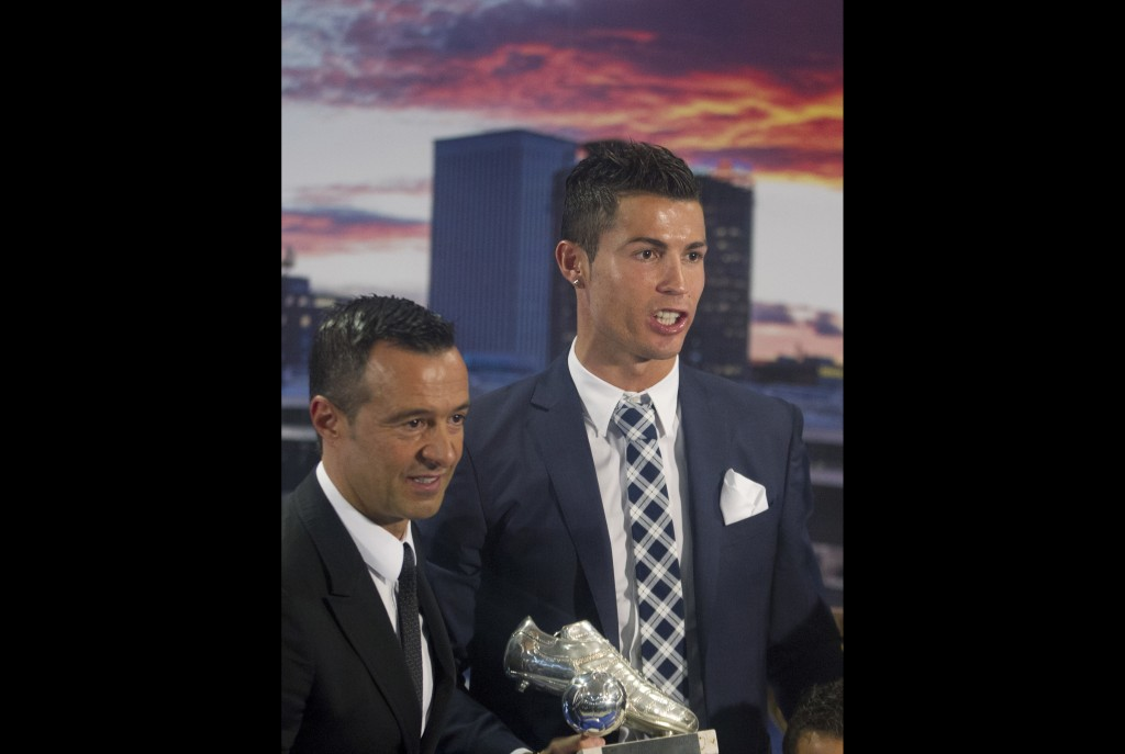 FILE - In this Friday Oct. 2, 2015 file photo, Real Madrid's striker Cristiano Ronaldo, right, poses with his agent Jorge Mendes after being given a s