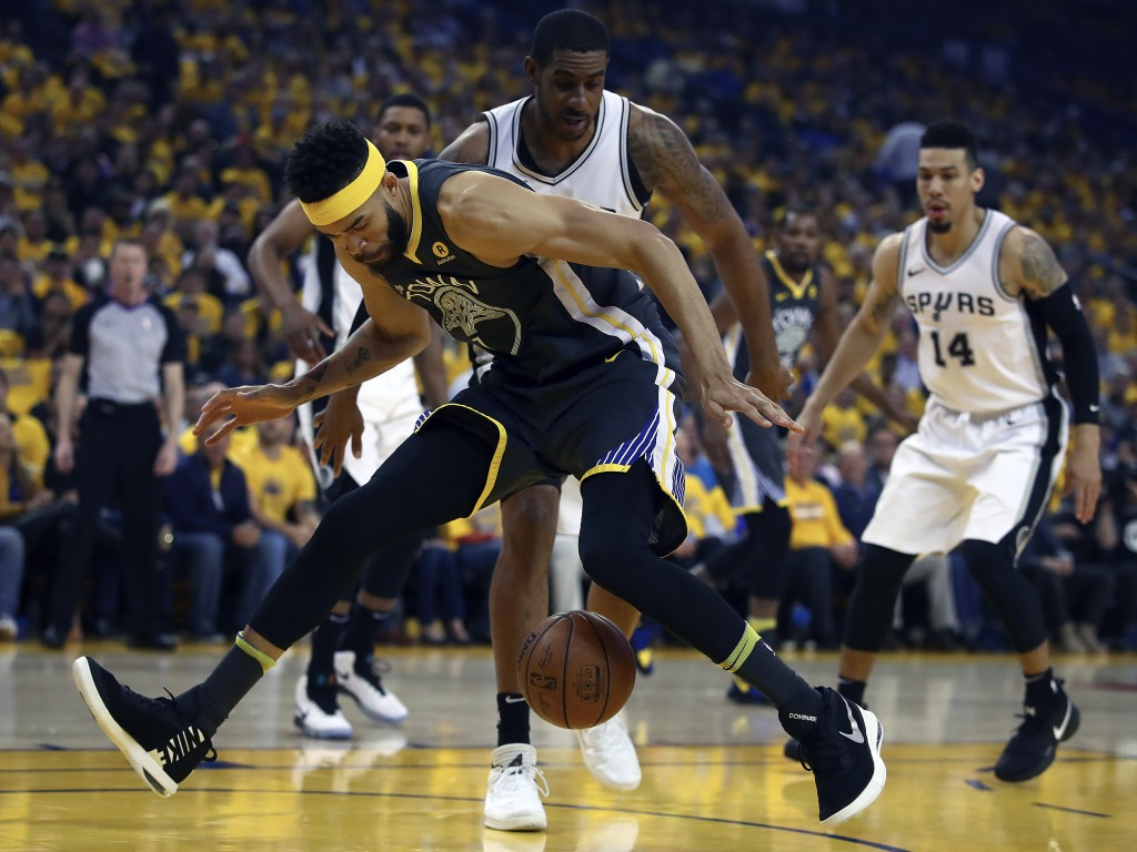 Golden State Warriors' JaVale McGee loses the ball between his legs in front of San Antonio Spurs' LaMarcus Aldridge during the first quarter in Game