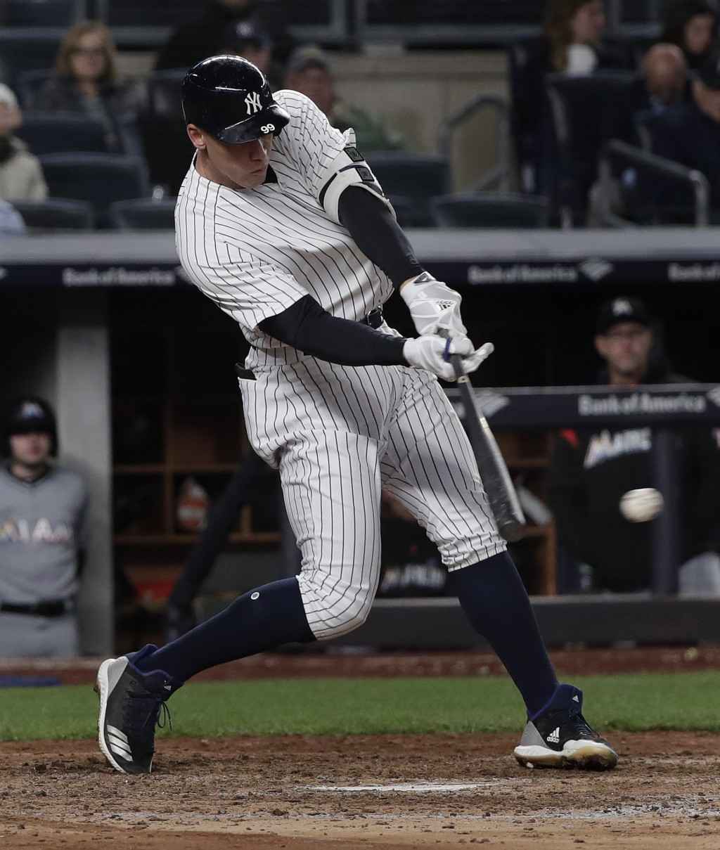 New York Yankees' Aaron Judge drives in a run on a base hit to left field during the fifth inning of a baseball game against the Miami Marlins, Monday