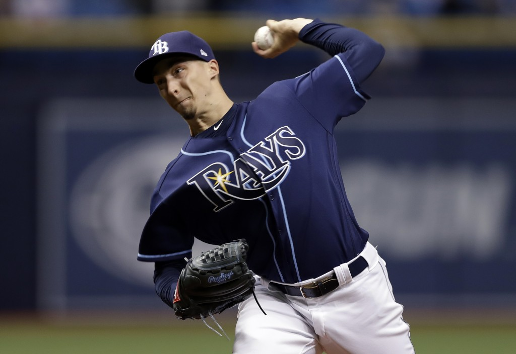 Tampa Bay Rays starting pitcher Blake Snell delivers to the Texas Rangers during the first inning of a baseball game Monday, April 16, 2018, in St. Pe