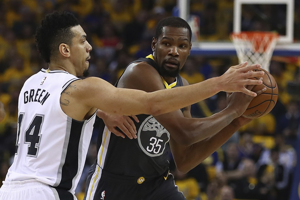 Golden State Warriors' Kevin Durant (35) is guarded by San Antonio Spurs' Danny Green (14) during the first quarter in Game 2 of a first-round NBA bas