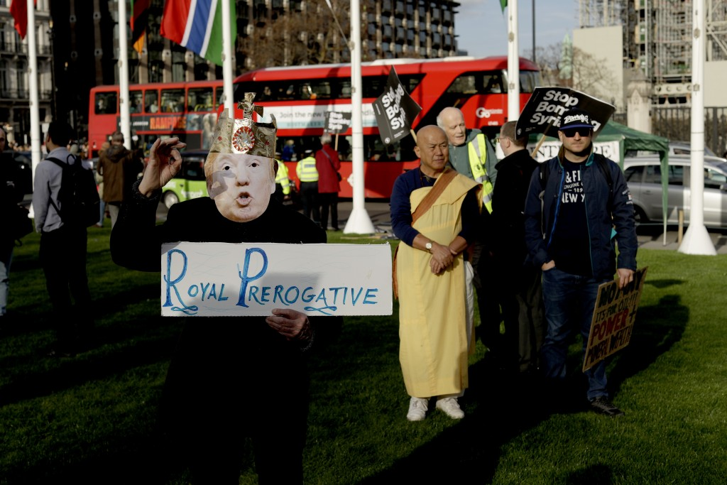 A demonstrator wearing a U.S. President Donald Trump mask and crown takes part in a protest organized by the Stop the War coalition against the Britis