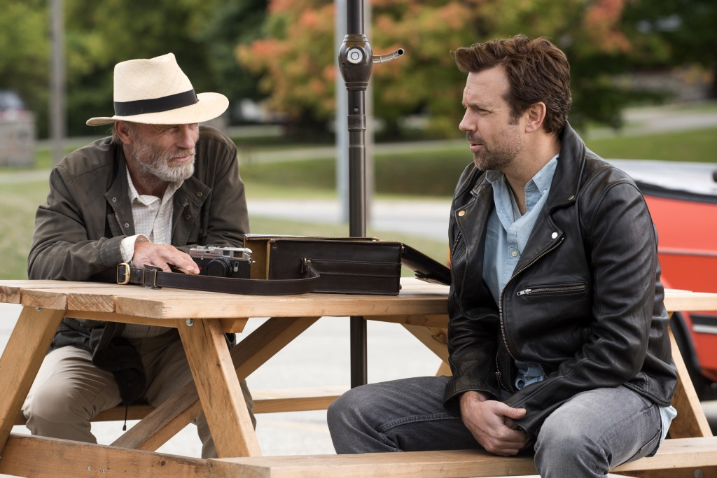 """This image released by Netflix shows Ed Harris, left, and Jason Sudeikis in a scene from """"Kodachrome."""" (Christos Kalohoridis/Netflix via AP)"""