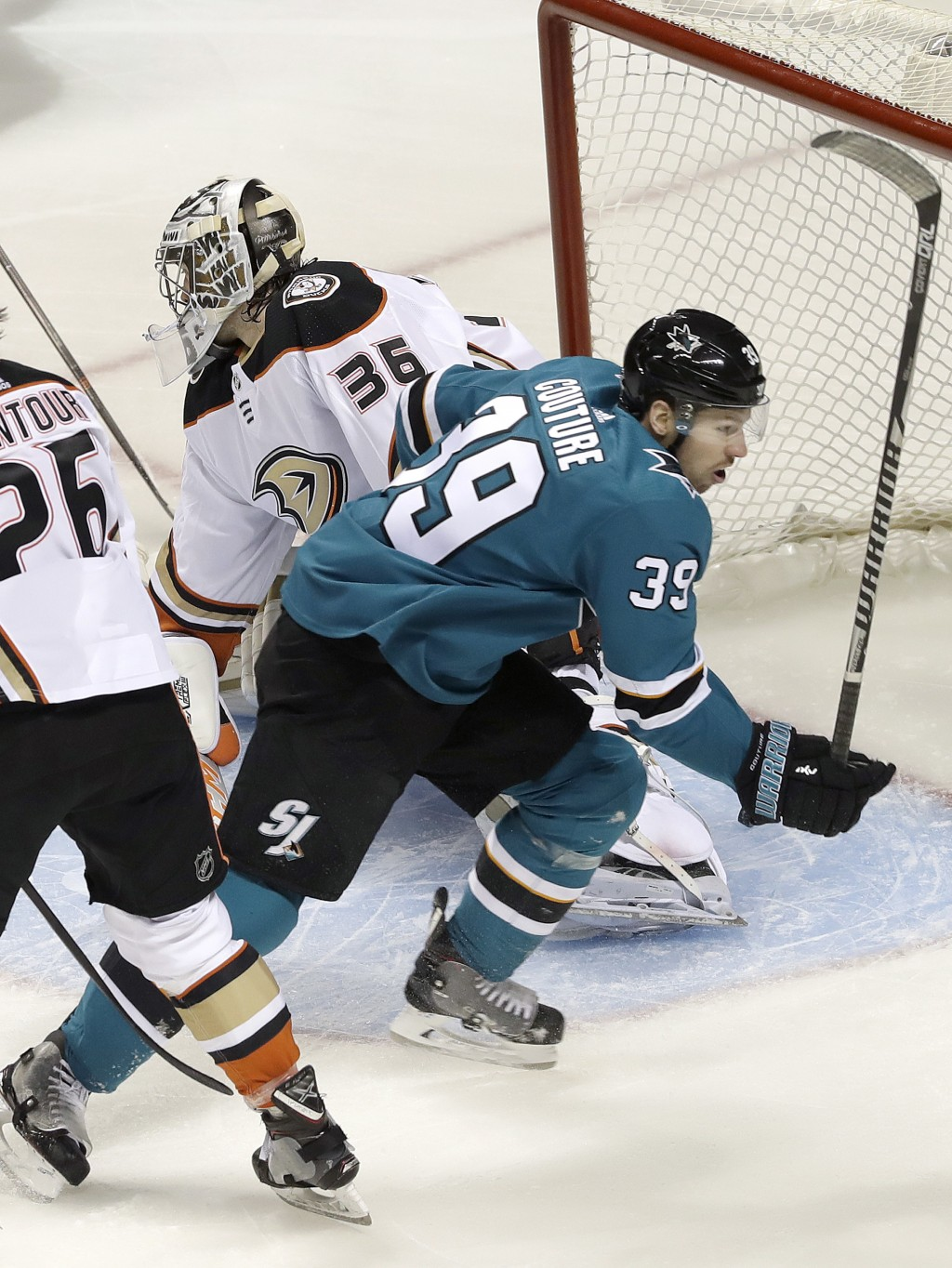 San Jose Sharks center Logan Couture (39) reacts after scoring a goal against Anaheim Ducks goalie John Gibson (36) during the first period of Game 3