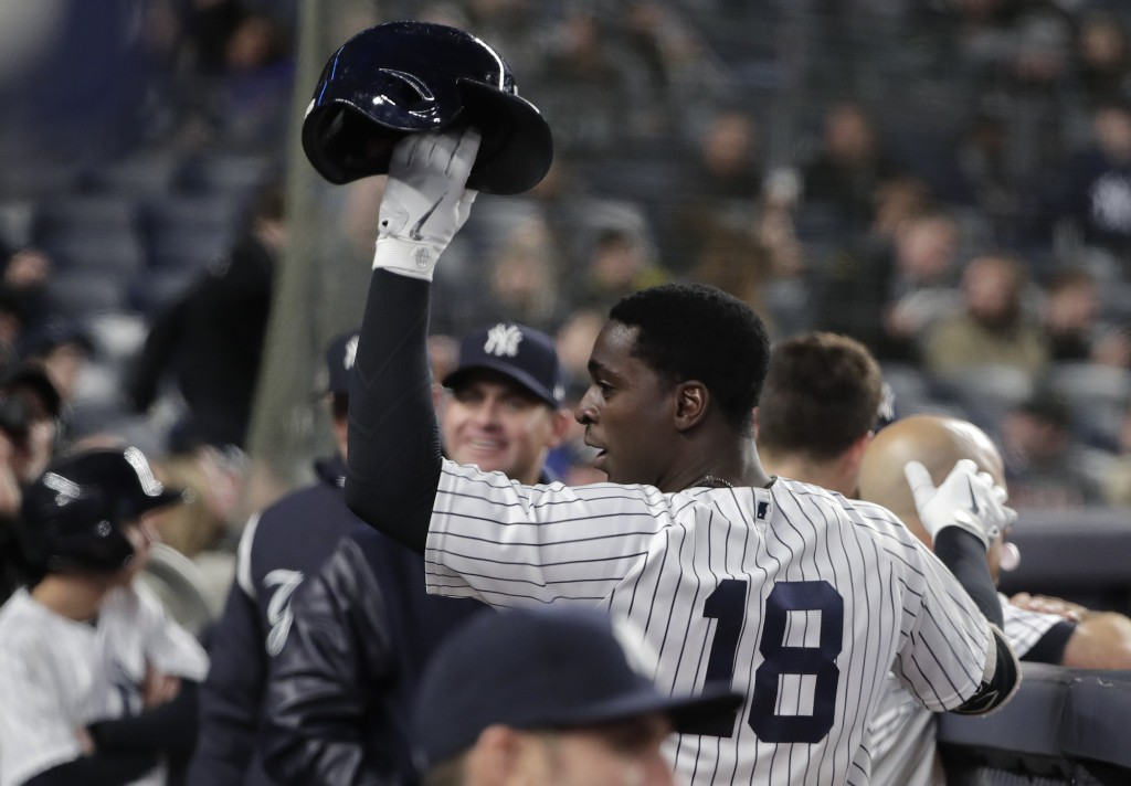 New York Yankees' Didi Gregorius (18) raises his batting helmet to the crowd after hitting a solo home run, his second of the game, against the Miami