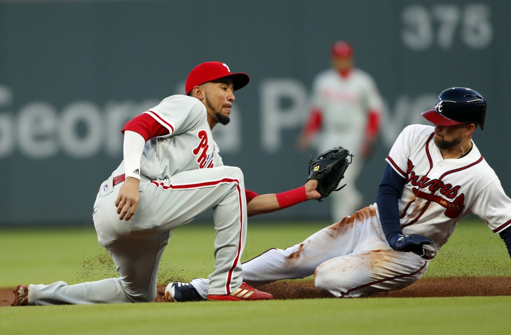 Atlanta Braves' Ender Inciarte (11) steals second base as Philadelphia Phillies shortstop J.P. Crawford (2) applies the late tag in the second inning