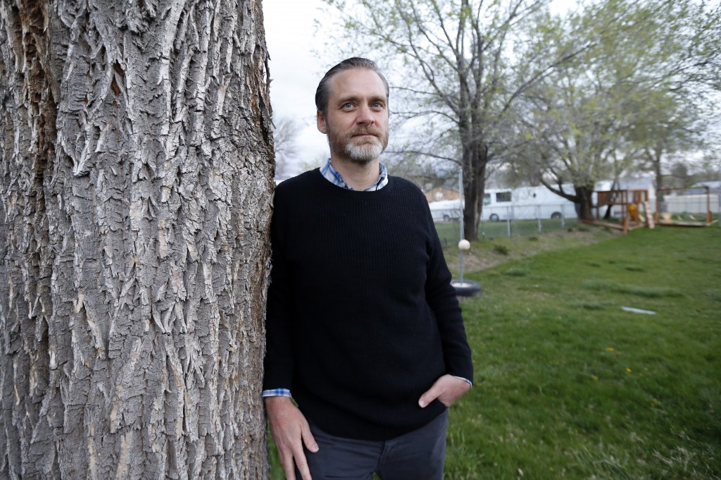 Nathan Frodsham, who suffers from cervical arthritis and disc disease, poses for a photograph at his home, Monday, April 16, 2018, in Murray, Utah. Vo
