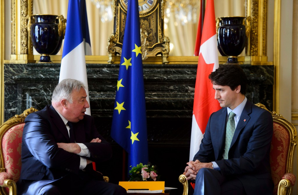 Prime Minister Justin Trudeau, right, meets with Speaker of the French Senate Gerard Larcher in Paris, France on Tuesday, April 17, 2018. (Sean Kilpat