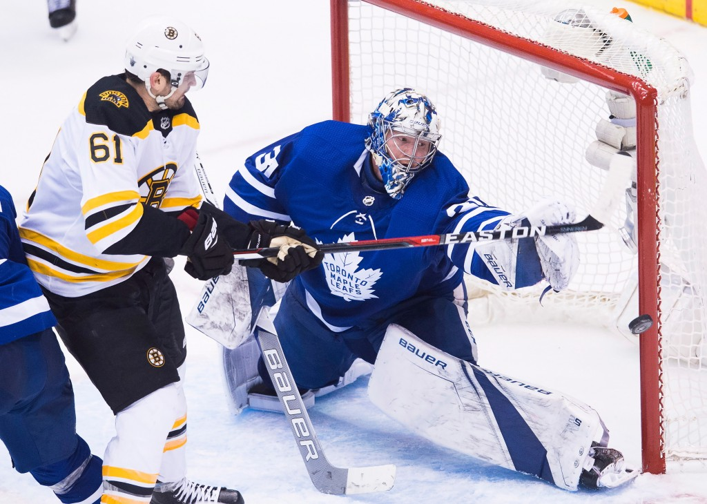 Toronto Maple Leafs goaltender Frederik Andersen (31) makes a save on a deflection by Boston Bruins left wing Rick Nash (61) during third period NHL,
