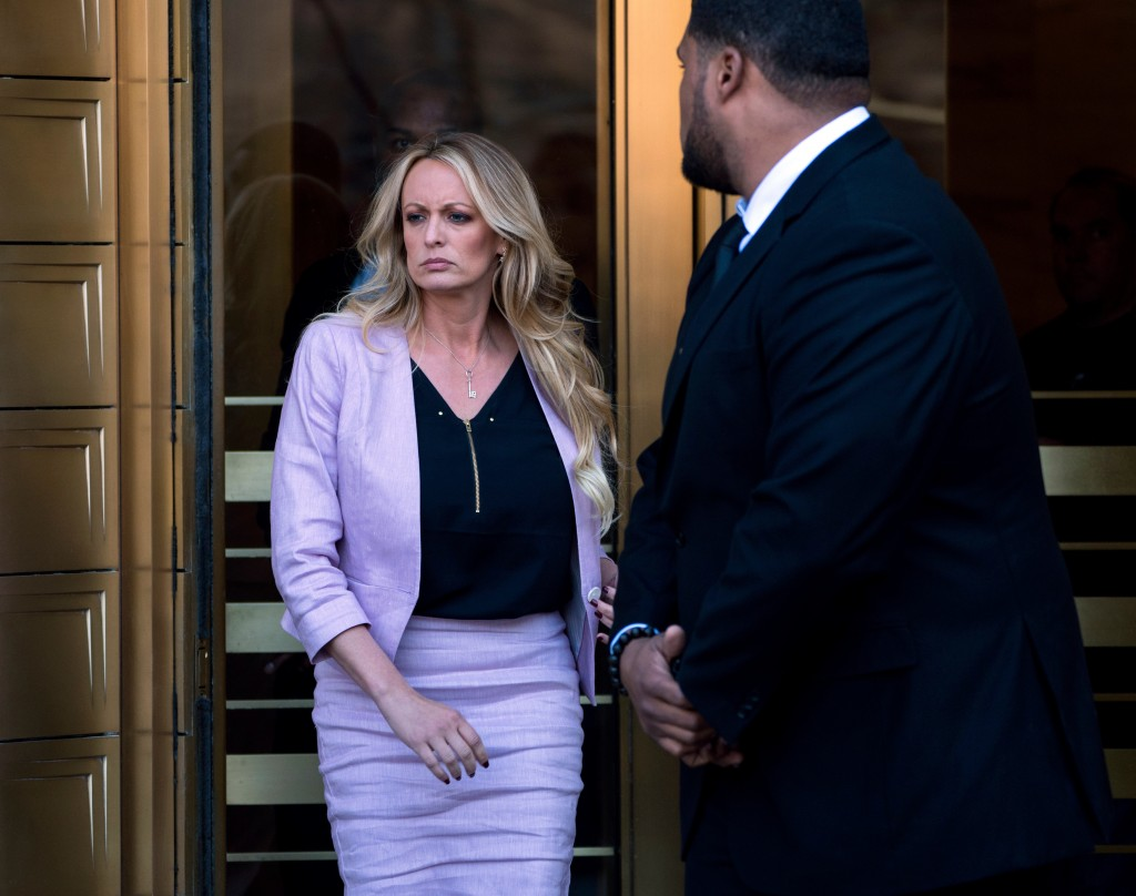 Adult film actress Stormy Daniels leaves federal court following a hearing Monday, April 16, 2018, in New York. (AP Photo/Craig Ruttle)