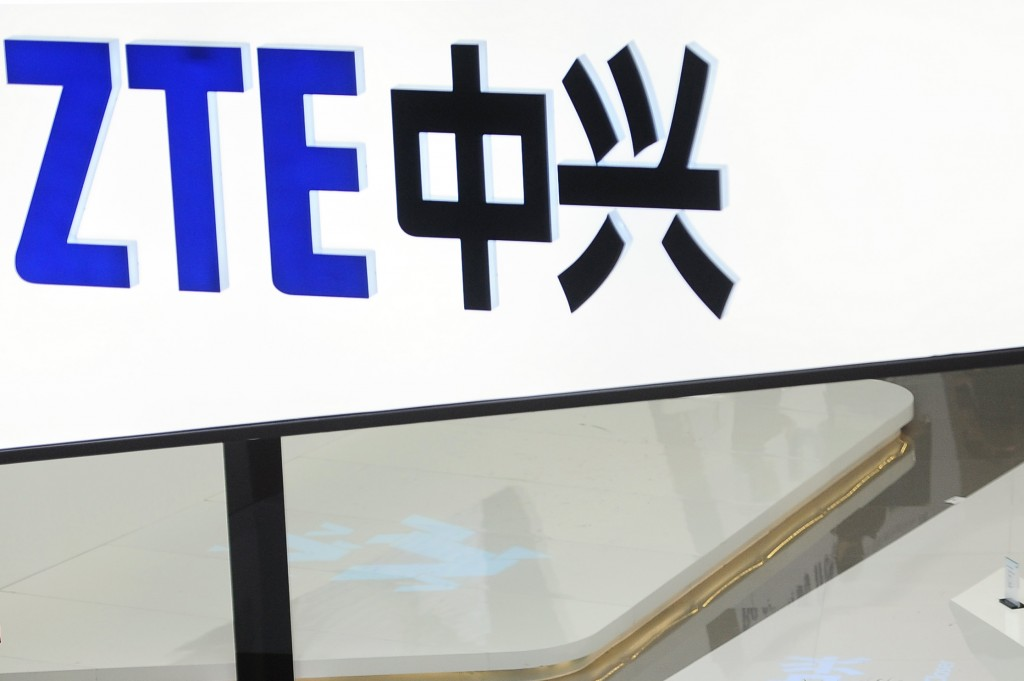 FILE- In this Feb. 26, 2014, file photo, a sign for the ZTE booth is seen at the Mobile World Congress, the world's largest mobile phone trade show in