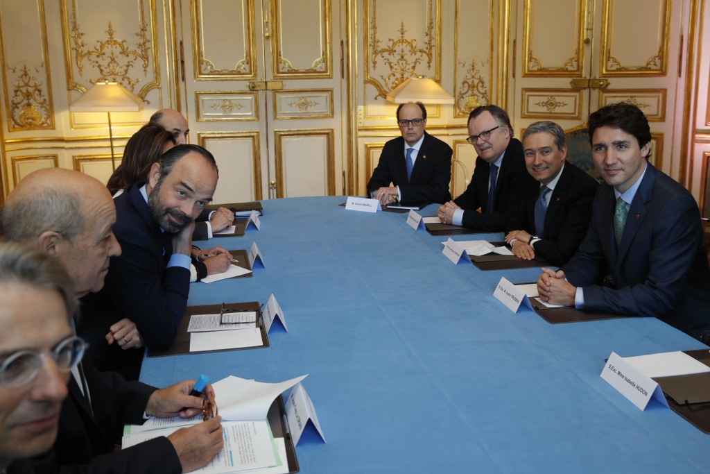 French Prime Minister Edouard Philippe, third left, and Canadian Prime Minister Justin Trudeau, right, attend a meeting at the Hotel Matignon in Paris