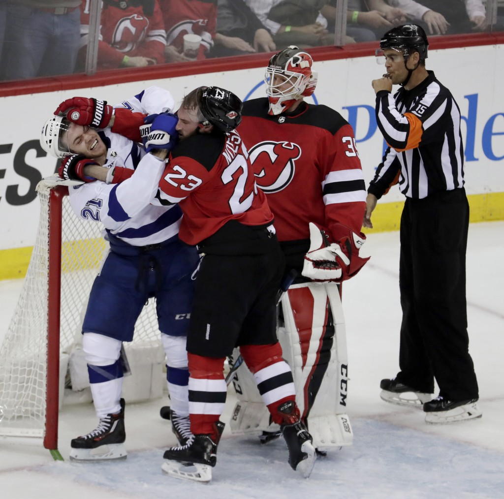 New Jersey Devils right wing Stefan Noesen (23) and Tampa Bay Lightning center Brayden Point (21) fight during the second period of Game 3 of an NHL f