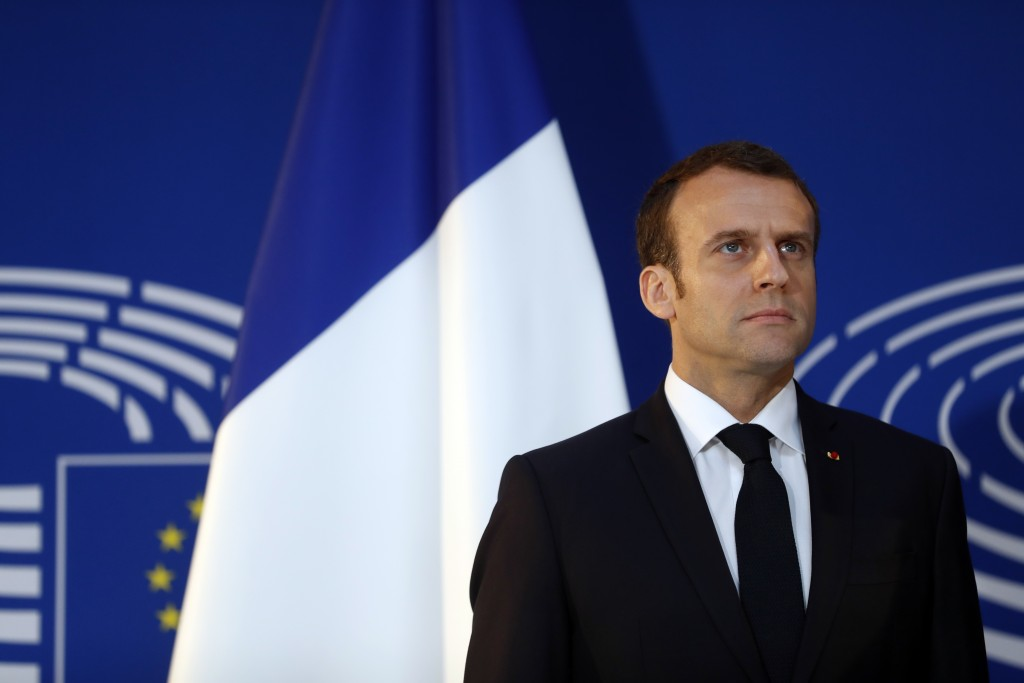 French President Emmanuel Macron, poses as he is welcomed by European Parliament president Antonio Tajani upon his arrival at the European Parliament