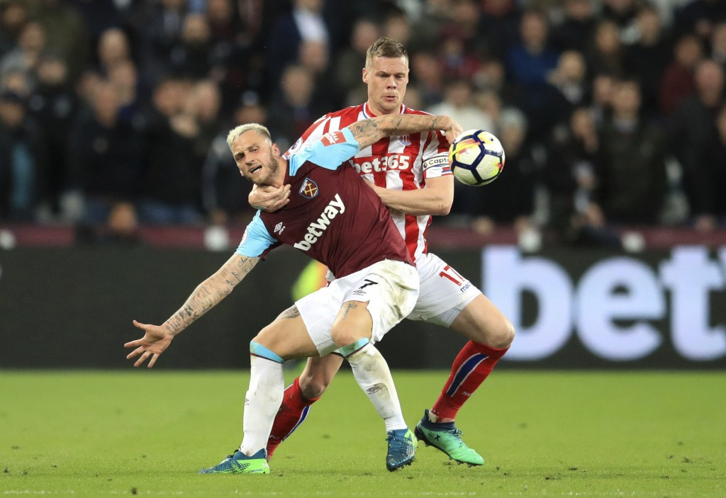 West Ham United's Marko Arnautovic, front, and Stoke City's Ryan Shawcross battle for the ball during the Premier League match at London Stadium Monda