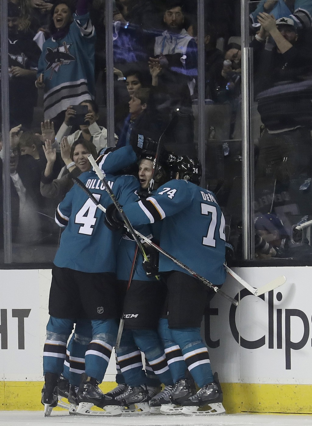 San Jose Sharks left wing Marcus Sorensen, center facing, from Sweden, celebrates with teammates after scoring a goal against the Anaheim Ducks during